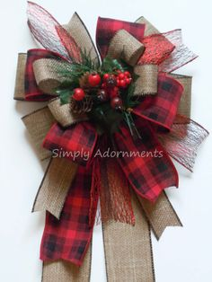 Made to Order Christmas wreath bow, Winter door hanger bow, Winter party decoration bow, Winter home decoration bow.  This bow is made of 4 different pattern ribbons. The ribbons are 2.5 and 1.5 width wire-edged ribbons. The bow includes pine cones and berries pick. Please select the bow size before checking out. The bow shown in this listing is the two (2) 12 tails option.  This bow is perfect for any Christmas tree decorations, centerpieces, wreaths, swags, staircase railings, rails, floor…