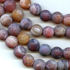 Sandblasted carnelian 18mm rounds.  The sandblasting has given the beads a striking effect.  Each bead is different.  A very light application of baby oil subtly brings out the color while retaining the frosted matte look.  Package of 2