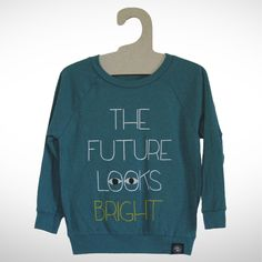 """""""The Future Looks Bright""""Color: Heather Teal50% Poly, 25% Cotton, 25% RayonMachine WashableMade in Sunny Los Angeles CA"""
