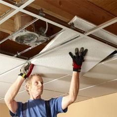Drop Ceiling Installation Tips: How to Install Drop Ceiling Tiles A pro shares his drop ceiling installation tips and demonstrates his techniques that will help you hang a suspended ceiling easier and faster. He shows how to lay it out, fasten grid Drop Ceiling Basement, Drop Ceiling Tiles, Wood Plank Ceiling, Shiplap Ceiling, Ceiling Grid, Dropped Ceiling, Basement Flooring, Ceiling Panels, Basement Kitchen