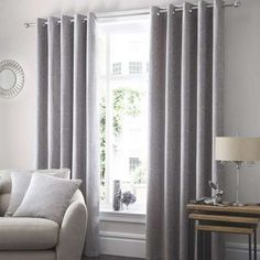 Printed with subtle damask style designs in grey over an elegant silver background, these fully lined curtains are complete with an easy to install eyelet heade...
