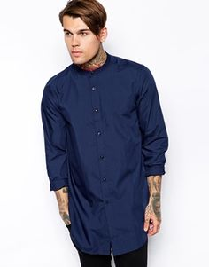 ASOS Smart Shirt In Long Line With Long Sleeves And Grandad Collar http://www.asos.com/ASOS/ASOS-Smart-Shirt-In-Long-Line-With-Long-Sleeves-And-Grandad-Collar/Prod/pgeproduct.aspx?iid=4211144&cid=6993&Rf-400=53&Rf900=1557&sh=0&pge=0&pgesize=36&sort=-1&clr=Navy