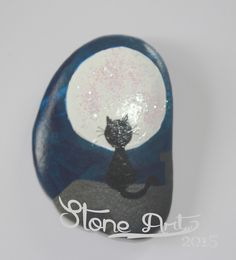 http://de.dawanda.com/product/87763519-handbemalter-stein---katze-auf-dem-blechdach