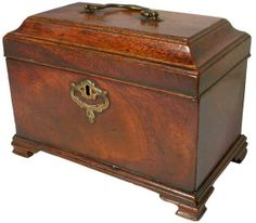 An early George III mahogany tea caddy of rectangular form, with moulded top, concealed drawer and original brass handle and escutcheon, raised on ogee bracket feet, old repairs to feet, 9.5in wide.