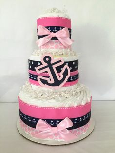 Nautical Diaper Cake in Pink and Navy, Nautical Baby Shower Centerpiece by AllDiaperCakes on Etsy https://www.etsy.com/listing/233674010/nautical-diaper-cake-in-pink-and-navy