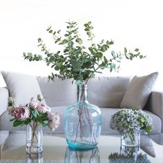 Artificial David Austin roses, dollar gum and hydrangea set in crystal clear water resin