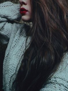 red lip, cozy sweater, long hair :)