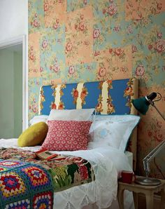 BoHo Chic | vintage look floral wallpaper, floral stripe, fresh white sheets, a touch of lace, handmade afghan, unmatched pillows