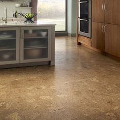 cork flooring is warm to the touch & good for sound insulation. it