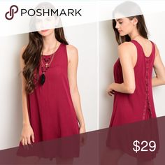 """Just in!!! Wine colored dress size small Size small wine colored dress with lace up detail in the back! Perfect for a party & or night out! Size is small underarm to underarm is 17"""" &  33"""" length. No trades, offers only through offer button not comments. (Color is more like the first photo, sorry my lighting isn't great in the second) Dresses"""