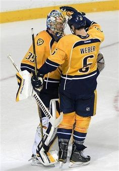Nashville Predators goalie Pekka Rinne, left, of Finland, and Shea Weber