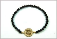 """stack, stack, stack! this intricately cut """"shema"""" prayer looks fantastic with our onyx favs."""