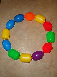 Fisher Price - pop beads. Had them for all my kids.