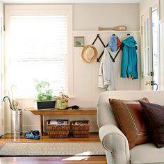 If your home isn't outfitted with the perfect entryway -- or any entryway at all -- build it yourself. Define the space with a rug, then add hooks and a bench to give purpose to a nearby wall.