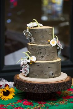 fall wedding cakes with initials carved | Their woodsy log wedding cake with carved initials.