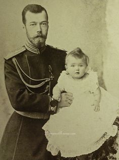 Proud father. Czar Nicholas II and his first child, Grand Duchess Olga.