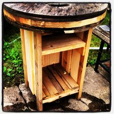 Bar Height Spool Table With Storage Below.