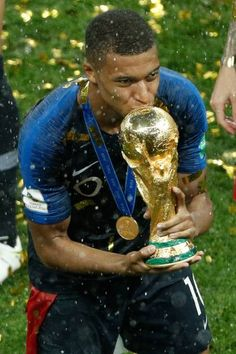 France s forward Kylian Mbappe kisses the trophy as he celebrates during  the trophy ceremony after winning the Russia 2018 World Cup final football. 6c0fab421