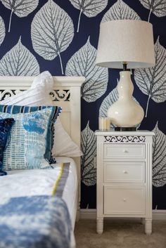 Stylish bedside cabinet and lamp in the master bedroom