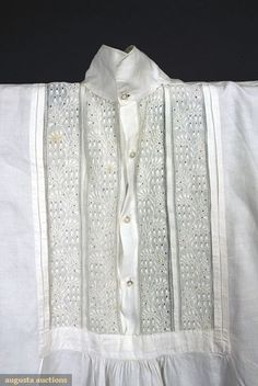 Augusta Auctions  Tasha Tudor collection  Gent's shirt c1850  White tabby linen, hand-stitched, inset bib decorated with tucks and whitework embroidery in floral vine pattern, small turn down collar, four center front shell buttons, long sleeves, curved tails and cuffs, small side gussets above slits, pristine.