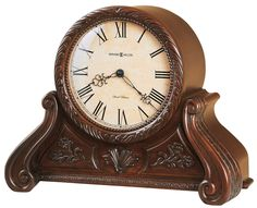 Cynthia Mantel Clock. With gorgeous wood detail and strong curves this decorative mantel clock will be the highlight of any home or office. Quartz, battery-operated, dual-chime Kieninger movement plays full Westminster or Ave Maria chimes with strike on the hour, with optional 4/4 chime feature which plays 1/4, 1/2, and 3/4 chimes accordingly. Volume control, automatic nighttime volume reduction option, and automatic nighttime chime shut-off option. Requires two C sized batteries