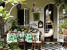 Love this table cloth. Quirky, quaint and cozy indoor/outdoor dining space.
