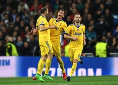 Mario Mandzukic of Juventus celebrates with teammate Giorgio Chiellini after scoring his sides second goal during the UEFA Champions League Quarter Final Second Leg match between Real Madrid and Juventus at Estadio Santiago Bernabeu on April 11, 2018 in Madrid, Spain.