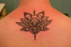 Lotus Flower tattoo at the Illustrator Tattoo in Dallas Ga.