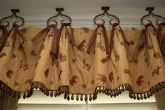 Love the hooks hanging from the ceiling on this valance.