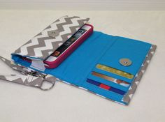 I really want one of these...https://www.etsy.com/listing/156338155/cell-phone-wallet-wristlet-for-your