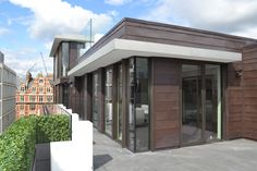 Hop House, Covent Garden - London Two Storey Penthouse, Copper Cladding, Bronze Curtain Walling, Floor to Ceiling Windows, Stainless Steel Canopy, Shingle Cladding Strips
