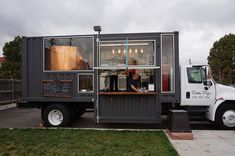 The Armstrongs prepping pizzas at a Denver craft brewery in their Simply Pizza food truck.