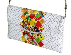 This minimalist thin clutch purse in an envelop shape is made using candy wrappers at the center part of the purse, and office document paper at its sides. Folded into strips and woven tightly.  Comes with a detachable and adjustable strap. Using a clip button for latching. Polyester fabric used for the lining. This purse has no inner pockets  It is available in two different sizes:  Small clutch: Dimensions in inches: 9 long, 5.5 tall, 1 thick (when stuffed can reach 1.7) Dimensions in…