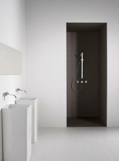 white bath + black shower + minimal