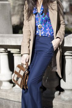 navy blue pants, pattern pink and blue top, camel coat