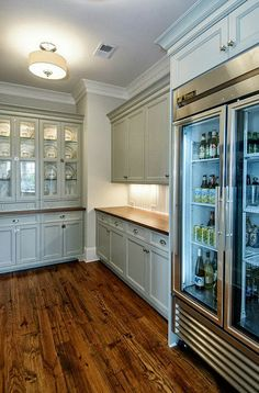 wall of cabinetry with glass doors and interior lighting... pretty color on cabinets, as well