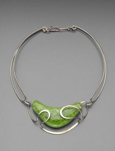 wow...note that date, the design is still fresh as can be...Necklace |  Elsa Freund, early 1950s.  Silver, glass, terracotta.