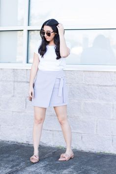 Between the Pearls | Spring Pastels Kestan white cotton tee, topshop light blue wrap skirt, zara nude/blush bow flasts, and quay my girl sunglasses