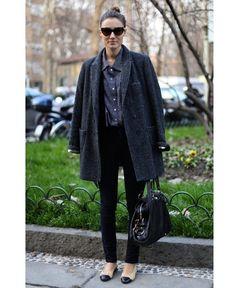 Oversized coat and skinny trousers are a hit with flat shoes in the colder months.