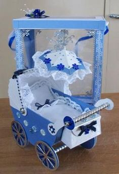 Blue pram:  This card was made for my husbands brother and wife for their 18th Anniversary.   I saw this style on Carols web page and it looked so good when she did