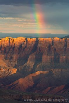 A rainbow crests the rim of the Grand Canyon (Arizona) by David Cobb