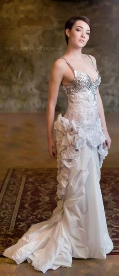 Wedding dress made by Totally Trashed Fashion out of paper, Saran Wrap, tinfoil, and vintage jewelry components.