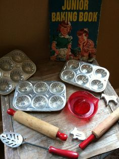 1953 Betty Crocker Junior Baking Book with vintage toy muffin tins, rolling pins, and more.