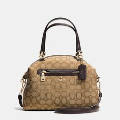 Updated in a graphic mix of custom-woven jacquard and smooth contrast leather, this simple, gracefully curved shape distills the satchel to its purest form. Very refined hardware complements its minimalist, hand-finished silhouette.