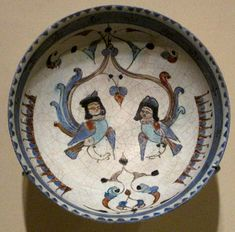Bowl depicting two harpies, winged spirits, from the Seljuq dynasty that ruled Persia, Mesopotamia and parts of Anatolia in the 11th and 12th century CE. The bowl dates back to late 12th - early 13th century CE with Persian poetry verses on the...