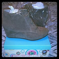 Taupe Wedge Booties **BRAND NEW** Taupe Wedge Booties. Super cute with skinny jeans or leggings. Never worn. Size 6.5 but could fit a 7 as they are too big for me. Bought from local boutique. Ready for a new home. Price Negotiable ?? Anna Shoes Ankle Boots & Booties