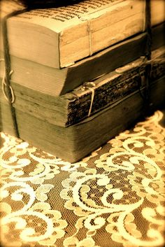 vintage book bundles and vintage lace make for a beautiful addition to your centerpiece design