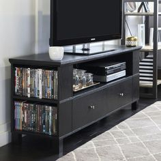 Center tv wall unit rustic floating stand black wood entertainment center b Black Entertainment Centers, Entertainment Center Wall Unit, Diy Entertainment Center, 60 Inch Tv Stand, 65 Inch Tvs, Black Tv Stand, Tv Decor, Home Decor, Storage Shelves