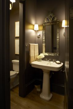 Separate room for toilet and dark, tall walls