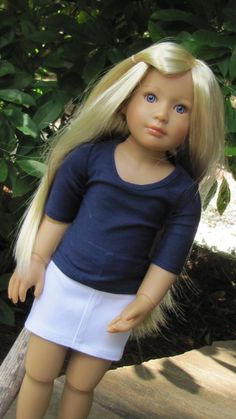 Kidz N Cats® Clothes Handmade Purple Denim Cut-Off Shorts and Striped Tank Your Kidz-n-Cats doll looks like a perfect California girl in her white denim mini skirt and navy t-shirt. The tee features b
